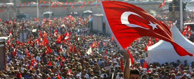 A man waves Turkey's national flag as he with supporters of various political parties gathers in Istanbul's Taksim Square during the Republic and Democracy Rally organised by main opposition Republican People's Party (CHP), Turkey, July 24, 2016.  REUTERS/Osman Orsal